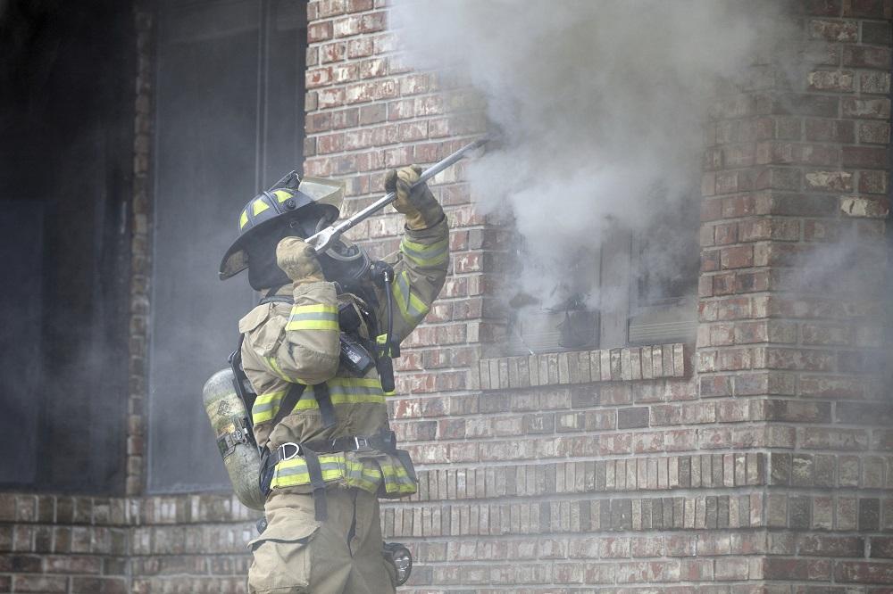 Firefighter-breaking-window
